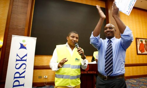 Brian Weke, CEO of Capacity Building Agency Consulting Ltd., (L), as he officially declared Wilfred Marube, (R), as the new President of Public Relations Society of Kenya, (PRSK).