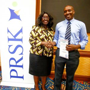 Jane Gitau, Public Relations Society of Kenya, (PRSK) former President, (L), beside Wilfred Marube, Public Relations Society of Kenya, (PRSK) current President during PRSK AGM at Serena Hotel.