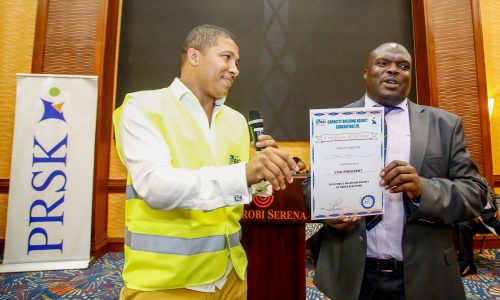 Brian Weke, CEO of Capacity Building Agency Consulting Ltd., (L), as he officially declared Mbugua Njoroge, (R), as the new Vice President of Public Relations Society of Kenya, (PRSK).