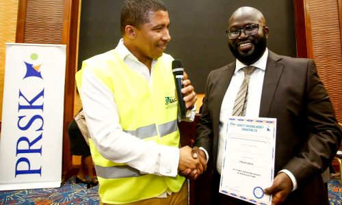 Brian Weke, CEO of Capacity Building Agency Consulting Ltd., (L), as he officially declared Arik Karani, the new Treasurer of Public Relations Society of Kenya, (PRSK).