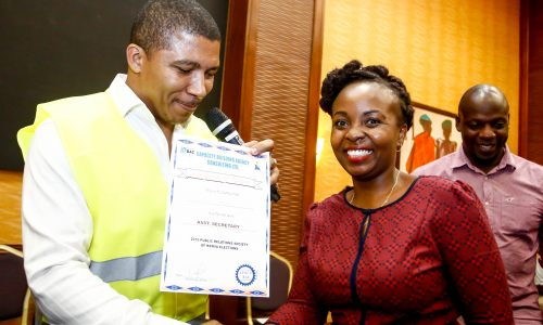 Brian Weke, CEO of Capacity Building Agency Consulting Ltd., (L), as he officially declared Vivienne Atieno as the new Assistant Secretary of Public Relations Society of Kenya, (PRSK).